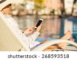 Woman Using Smartphone By The...