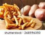 tasty french fries in metal... | Shutterstock . vector #268596350