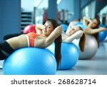 group of people in a pilates... | Shutterstock . vector #268628714