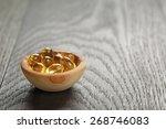 Fish Oil Capsules In Wood Bowl...