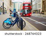 row of bicycles for rent with... | Shutterstock . vector #268764323