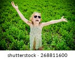 cute little girl on a meadow in ... | Shutterstock . vector #268811600