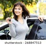 pretty girl showing the car key  | Shutterstock . vector #268847513