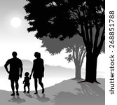 silhouette of parents walking...