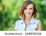 portrait of smiling beautiful...   Shutterstock . vector #268858106
