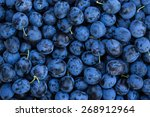 ripe plums background | Shutterstock . vector #268912964