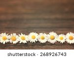 daisy on wooden background with ... | Shutterstock . vector #268926743