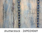 chain on weathered wooden... | Shutterstock . vector #269024069