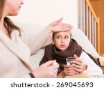 woman caring for sick daughter... | Shutterstock . vector #269045693