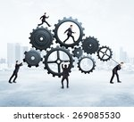 five businessman runs gears on... | Shutterstock . vector #269085530