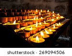 Votive Candles In A Group Burn...
