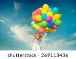 happy child jumping with... | Shutterstock . vector #269113436