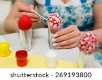 woman paints the easter eggs... | Shutterstock . vector #269193800