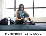 beautiful woman tying shoelaces ... | Shutterstock . vector #269243096
