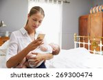 working mother holding baby and ... | Shutterstock . vector #269300474