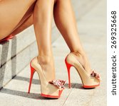 woman legs in high heels   | Shutterstock . vector #269325668