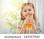 a beautiful girl drinking fresh ... | Shutterstock . vector #269357900