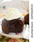 Small photo of chocolate fondant with whipped cream