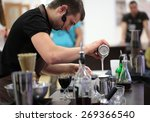 Постер, плакат: Barista Dmitry Shevchenko makes