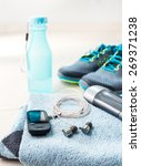 Small photo of Pair of sport shoes and fitness accessories. Fitness concept