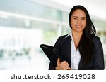 young brunette holding file... | Shutterstock . vector #269419028