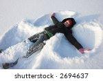 Young Woman Making A Snowangel