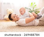 mother holds cute baby | Shutterstock . vector #269488784