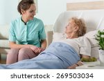 elderly lady in a hospital bed