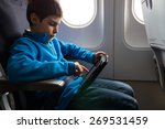young kid relaxing using tablet ... | Shutterstock . vector #269531459