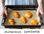 Man Holding Oven Tray With...