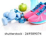 Fitness Concept With Dumbbells...