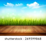 Wooden Deck In Front Of Green...