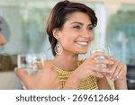 two girls holding glass of... | Shutterstock . vector #269612684