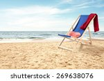 coastline and red towel blue... | Shutterstock . vector #269638076
