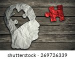 Stock photo puzzle head brain concept as a human face profile made from crumpled white paper with a jigsaw 269726339