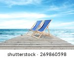 wooden pier and summer chairs