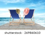 summer chairs hats and pier of...