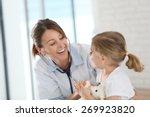 doctor examining little girl... | Shutterstock . vector #269923820