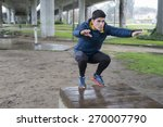 man squatting in a park on a... | Shutterstock . vector #270007790