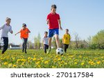 boys kicking football on the ... | Shutterstock . vector #270117584