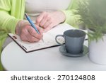Close Up Of Woman Writing In...