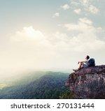 hiker relaxing on the rock | Shutterstock . vector #270131444