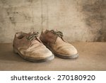 Brown Old Leather Shoes On Wood ...