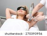 blonde woman having underarm... | Shutterstock . vector #270393956