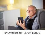 senior man at home reading on a ... | Shutterstock . vector #270416873