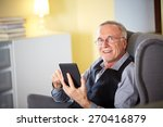 senior man at home reading on a ... | Shutterstock . vector #270416879