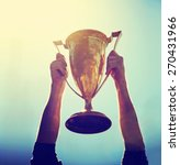 a man holding up a gold trophy... | Shutterstock . vector #270431966