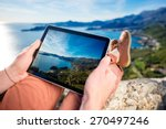 Man Holding Digital Tablet On...