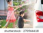 asian children washing car in...   Shutterstock . vector #270566618