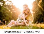mother is cuddling her worried... | Shutterstock . vector #270568790
